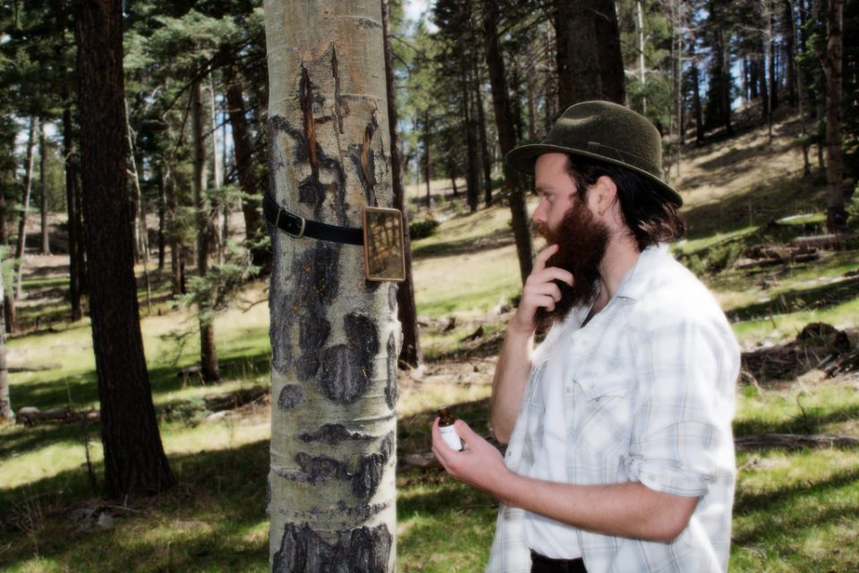 Man-In-Forest-Using-Beard-Oil-From-The-Mod-Cabin