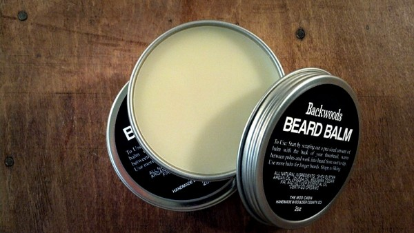 Backwoods Beard Balm is an all-natural, light to medium hold, multi-purpose pomade with a warm, woodsy scent. Backwoods Beard Balm instantly makes your beard appear thicker, and keeps your beard moisturized throughout the day. It can also be used as a pomade for hair.