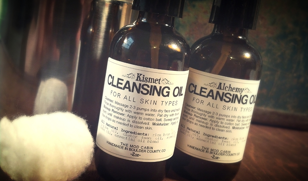 The Mod Cabin Cleansing Oils - Our cleansing oils are formulated for use by both men and women. Kismet Cleansing Oil is a cleanser, moisturizer, and makeup remover all in one. This all-natural cleanser is formulated based on the principles of the Oil Cleansing Method, a practice as old as the hills. This gentle, non-soap formula will not strip your skin of it's natural layer of lipids like other harsh cleansers will. Kismet Cleansing Oil wipes away dirt and grime and leaves your face fresh and dewy, without leaving your face feeling greasy.