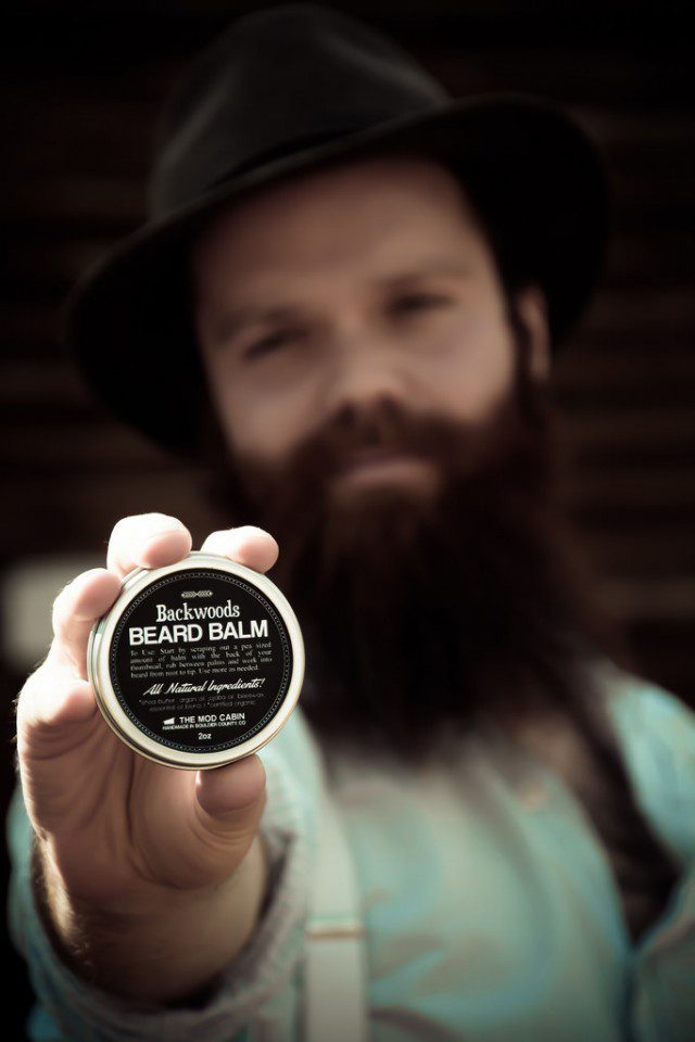 Bearded-Man-Holding-Backwoods-Beard-Balm-From-The-Mod-Cabin
