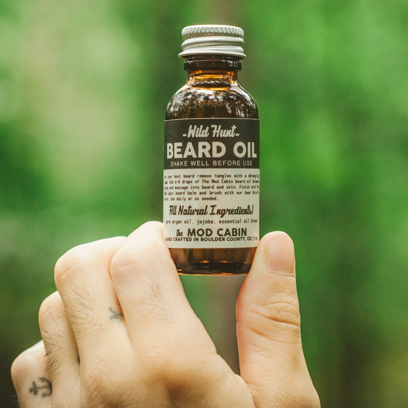 Man Holding The Mod Cabin All Natural Beard Oil