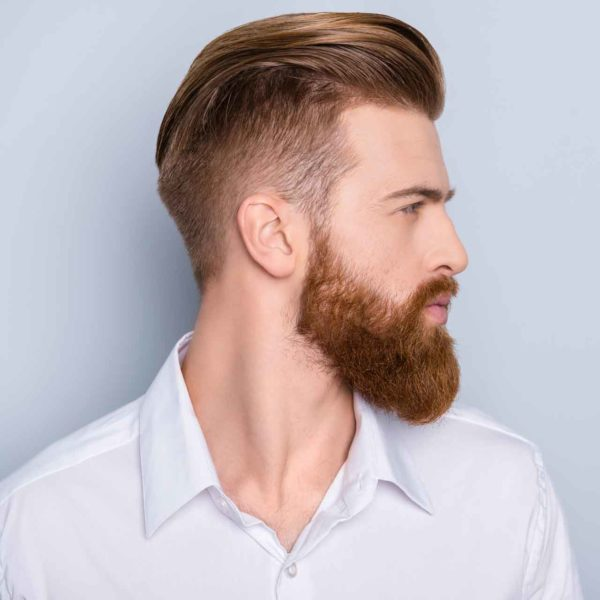 Man Wearing The Mod Cabin Classic Pomade with a slick back style